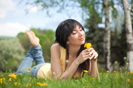 Cute woman in the park with dandelions Stock Photo - 7225459