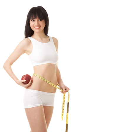 woman with red apple and measure tape  photo