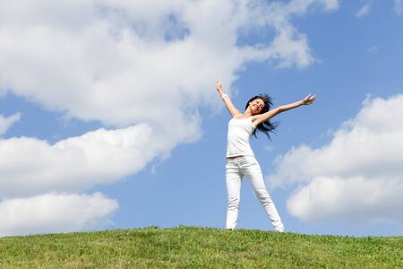 happy young woman dreams to fly on winds Stock Photo - 7258829