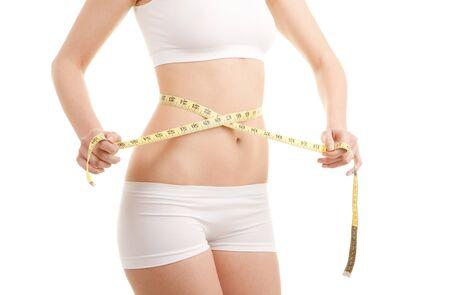 cintura perfecta: Mujer atl�tica con cinta de medida  Foto de archivo