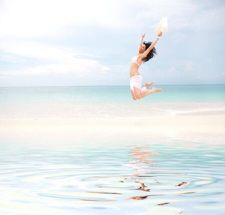happy young woman jumping in the beach Stock Photo - 7277324