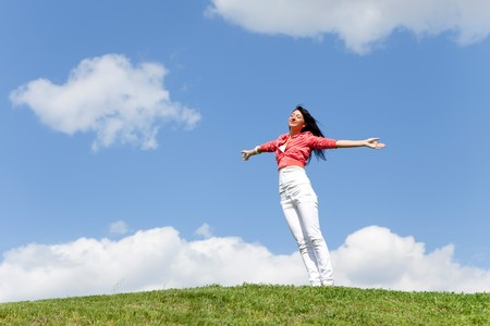 happy young woman dreams to fly on winds Stock Photo - 7317918