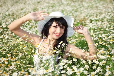 young happy girl in the daisywheel field  photo