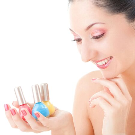 Elegant woman with colored polishes   photo