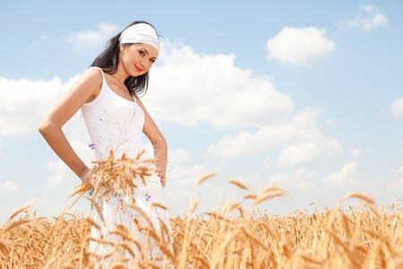 �ute woman in golden wheat photo