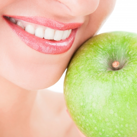 healthy teeth and green apple photo