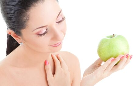 sweet girl eating green apple on white background  photo
