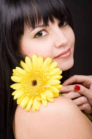 Young woman with gerber flower  photo