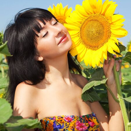 fun woman in the field of sunflowers  photo