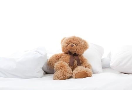 fun teddy bear sitting on bed Stock Photo - 8144993