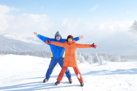 Happy couple with ski in the winter landscape   photo