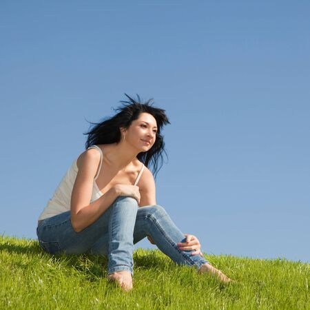 happy young woman rest on the green grass  Stock Photo - 8523934