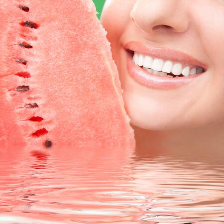 healthy teeth and red watermelon  photo
