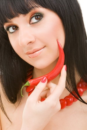 cute girl with chili pepper  photo