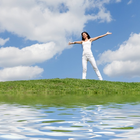 vitality: happy young woman dreams to fly on winds  Stock Photo