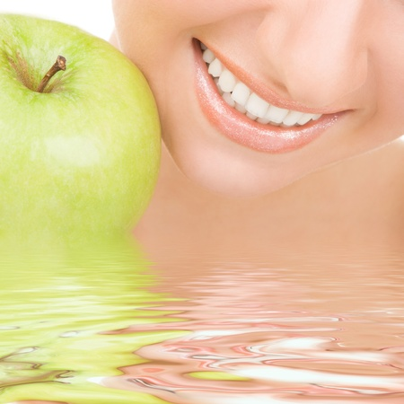 dental smile: healthy teeth and green apple