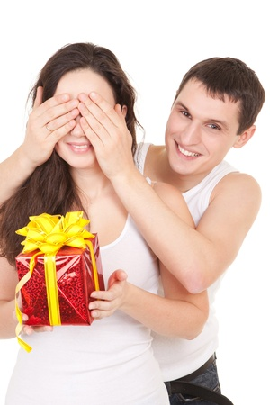 Young man presents gift to woman, on white background Stock Photo - 9112019