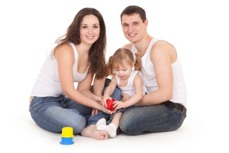 young happy family playing with a baby  photo
