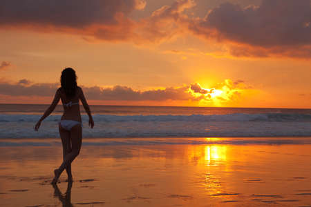 silhouette of woman on the sunset  photo