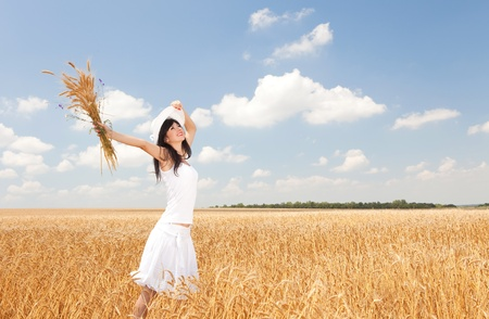 Young woman in golden wheat  photo