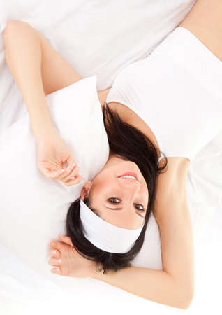 Sexy woman lying on the white bed  Stock Photo - 9427048