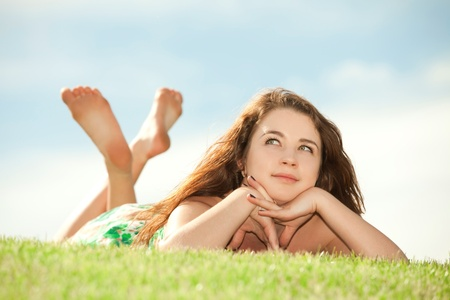 happy young woman rest on the green grass Stock Photo - 10056213