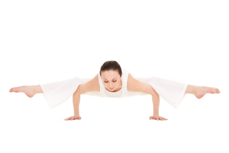 Young woman doing yoga exercise photo