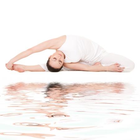 Young woman doing yoga exercise Stock Photo - 10056323