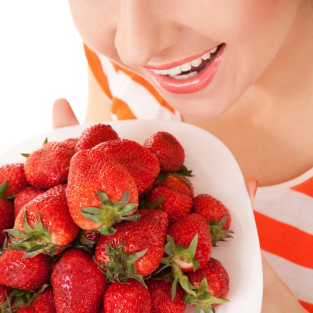 Fun woman with strawberry on the white background photo