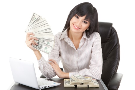 finance director: Elegant business woman with pile of money Stock Photo