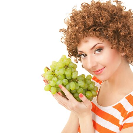 Pretty woman with grape on the white background photo