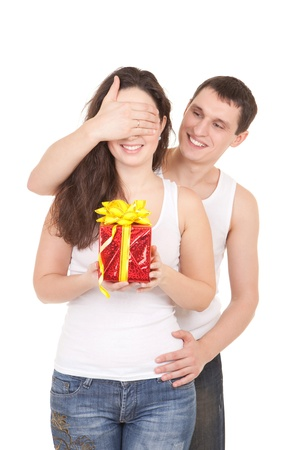 Young man presents gift to woman, on white background photo