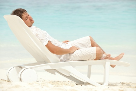 Happy man rest on the beach Stock Photo - 11743272