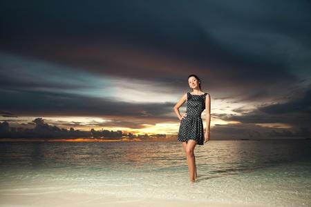 Fashion woman on the sea sunset background Stock Photo - 11743285