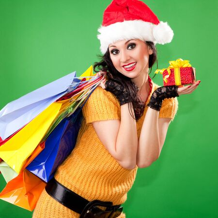 Fun santa woman with gift box and color packages photo