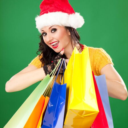 Fun santa woman with color packages photo