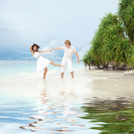 Young couple on the beach of sea Stock Photo - 12434527