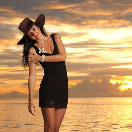 evening dress: Fashion woman on the sea sunset background
