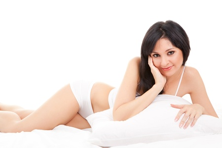 Cute woman lying on the white bed Stock Photo - 12671828