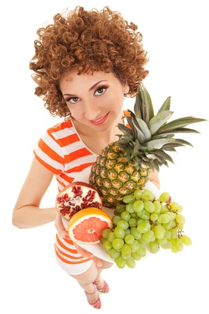 Fun woman with juicy fruits on the white background photo