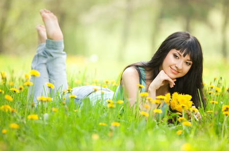 Young woman in the park with flowers Stock Photo - 12941661
