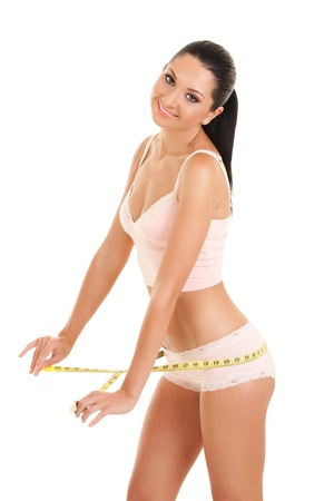 happy young woman with measure tape photo