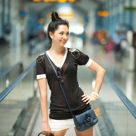 Young pretty woman in the airport photo