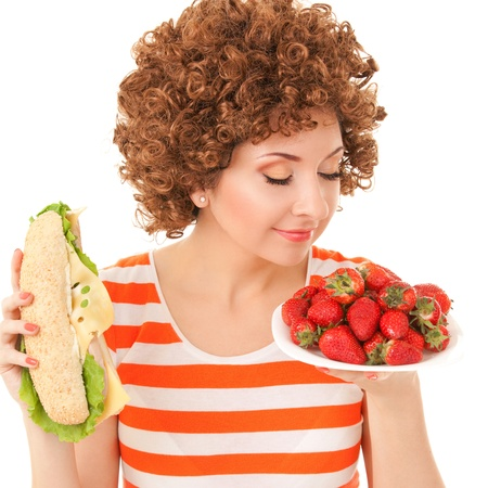 Fun woman with strawberry and sandwich on the white background photo