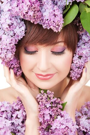 purple lilac: Young woman with lilac flowers Stock Photo
