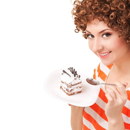 fun woman eating the cake on the white background photo