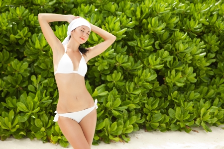 Fashion woman relax on the beach vegetation background photo