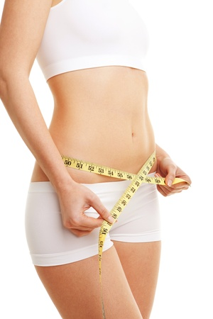weight loss success: woman with measure tape