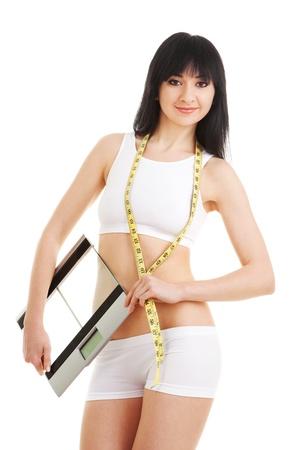 cintura perfecta: Mujer bonita con regla de vidrio y cinta m�trica