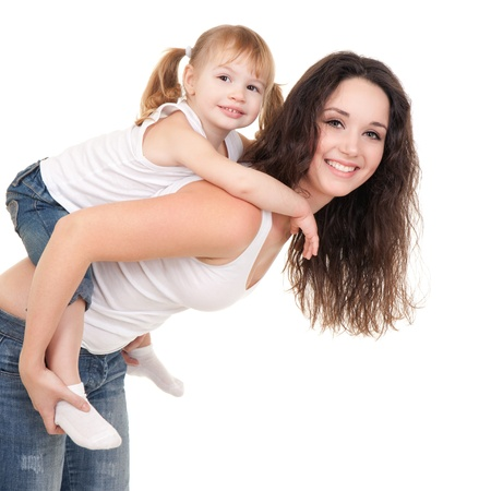 Happy mother and daughter playing on the white background photo